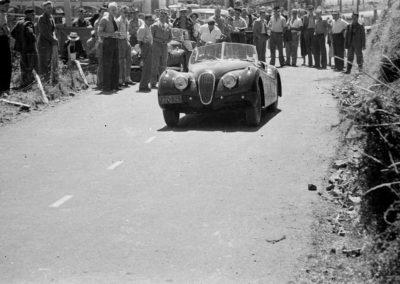 Bob Gibbons in Jaguar XK 120, Paekakariki Hill Climb 1951 - Alexander Turnbull Library