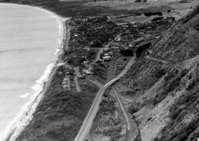 A view overlooking Paekakariki. South End shows the main highway and houses.  - Alexander Turnbull Library