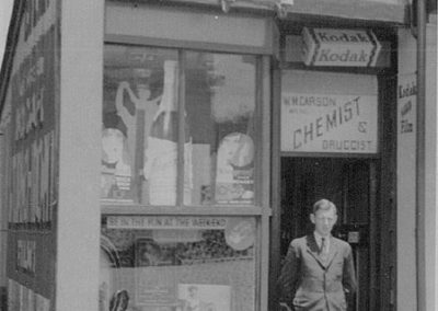 Bill Carson in doorway of his 1st Shop - Carson Collection
